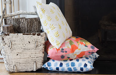 Roostery pillows featuring designs from the Spoonflower Marketplace.