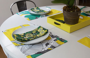 Roostery napkins and placemats featuring designs from the Spoonflower Marketplace.