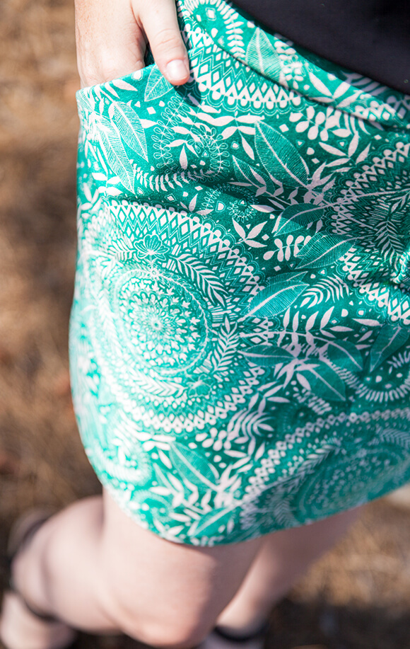 Image from above of a woman wearing a green and white leave and mandala doodle design made from Celosia Velvet.