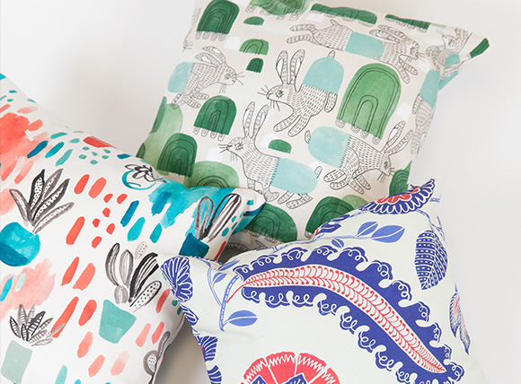 Close up image of pillows made from Cypress Cotton Canvas with designs by