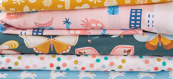 Layout of 5 multi-colored Petal Signature Cotton printed fabrics from Spoonflower.