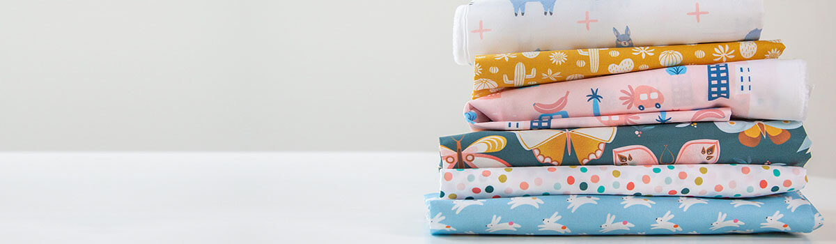 Colorful designs printed on Spoonflower's new Petal Signature Cotton Fabric